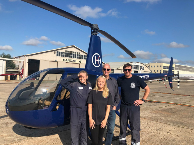 Student Pilot standing with Instructors.