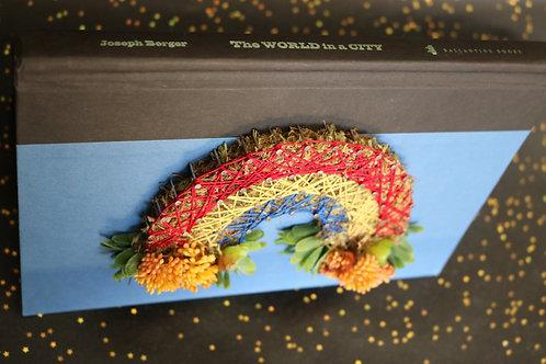 Rainbow String Art On Discarded Book