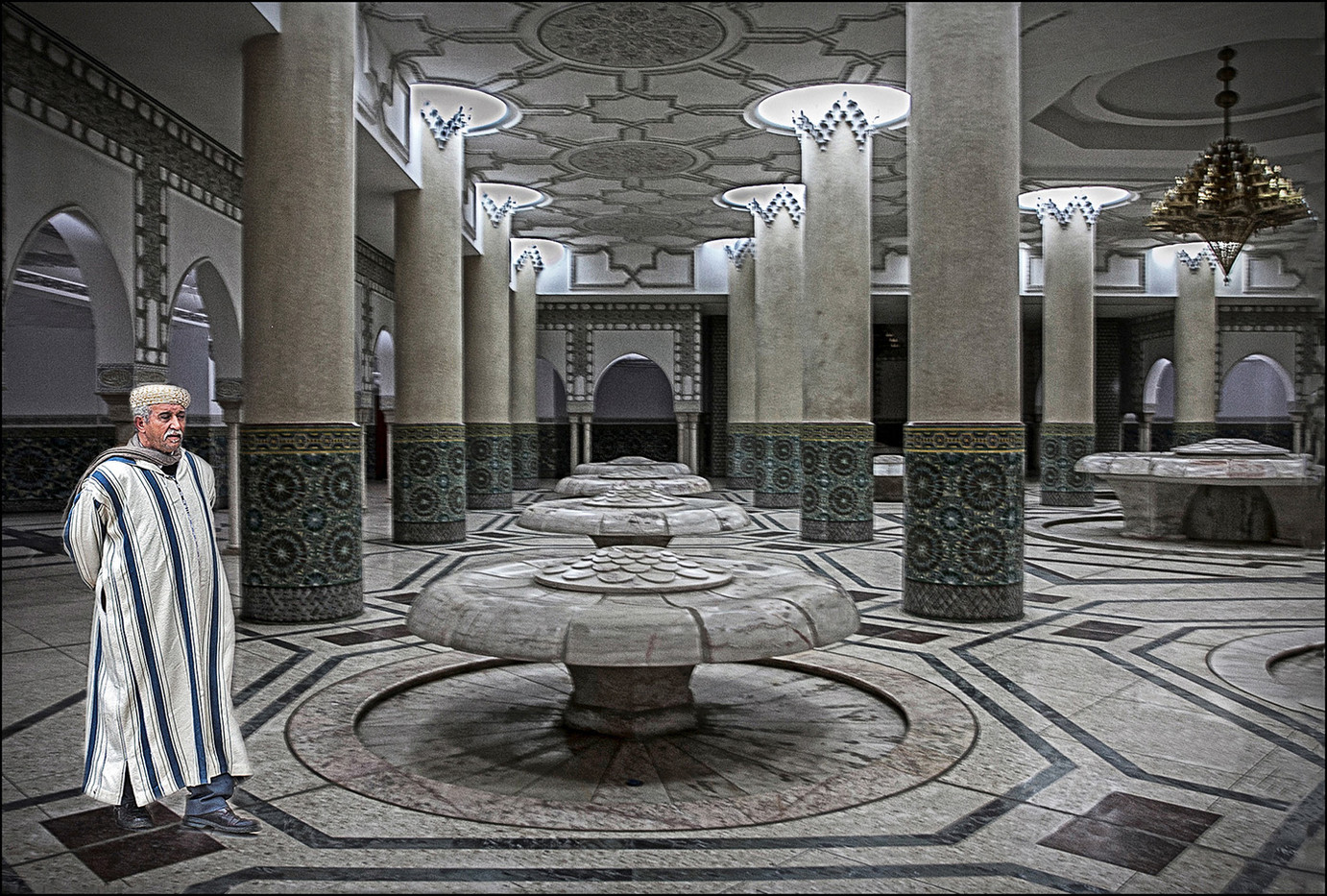 14 WALKING THROUGH THE FOUNTAINS BENEATH KING HASSAN II MOSQUE CASABLANCA by Graham Bunyan