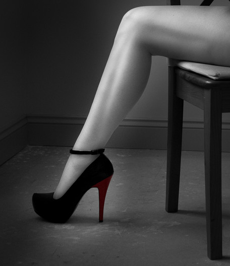 20 THREE LEGS AND A RED HEEL by Tony Hill