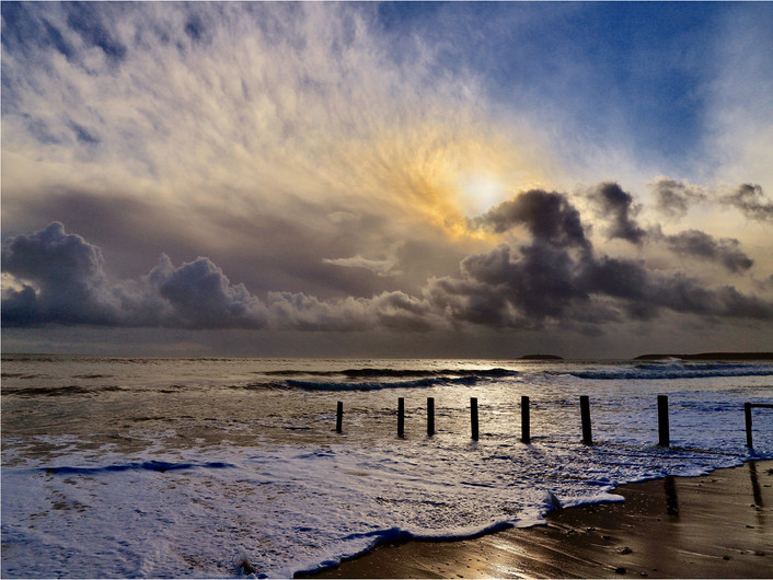 19 STORMY SUNRISE PILMORE STRAND IRELAND by Dave Brooker