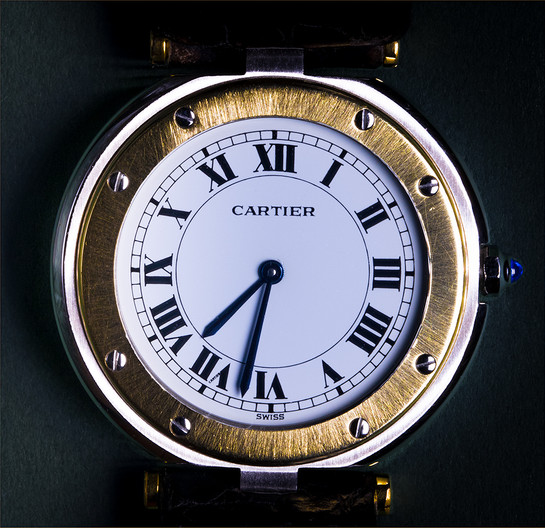 16 WATCH FACE SHOWING THE WORD CARTIER WITHIN ROMAN NUMERAL SEVEN PROVING IT TO BE THE GENUINE ARTICLE by Sonia Peek