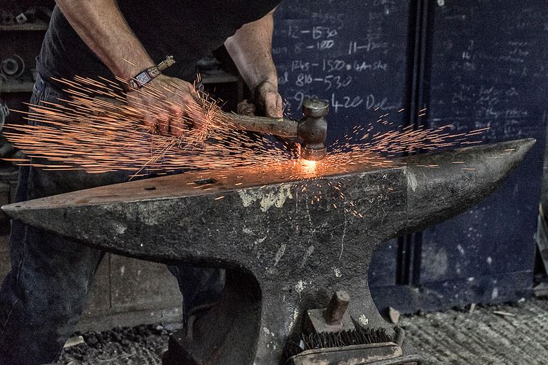 17 BLACKSMITH AT WORK by Colin Smith