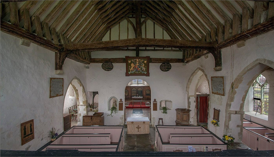 14 12TH CENTURY ST CLEMENT CHURCH OLD ROMNEY. ITS 18TH CENTURY PEWS WERE PAINTED PINK FOR THE 1963 FILM DR SYN by Philip Smithies