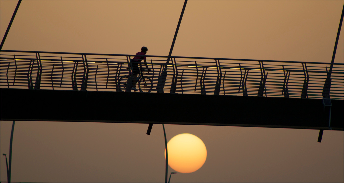 18 CYCLIST AT SUNDOWN by Dave Brooker