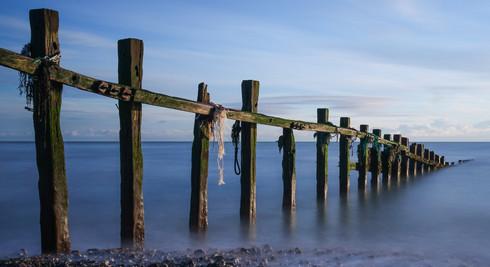 SEA BATTERED GROYNES by Bryan Ellis
