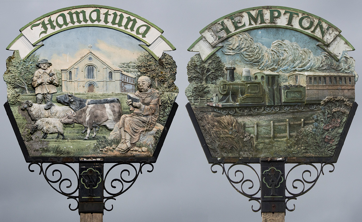 14 BOTH SIDES OF THE VILLAGE SIGN OF HEMPTON IN NORFOLK. ITS EARLY ENGLISH NAME WAS HAMATUNA by Philip Smithies