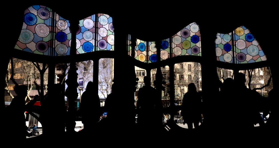 16 SILHOUETTES IN A GAUDI WINDOW by Richard Gandon
