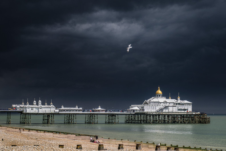 19 STORM BREWING OVER EASTBOURNE by John Lewis