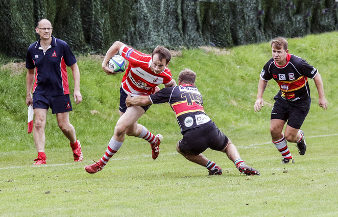 BREAKING A TACKLE by Denys Clarke