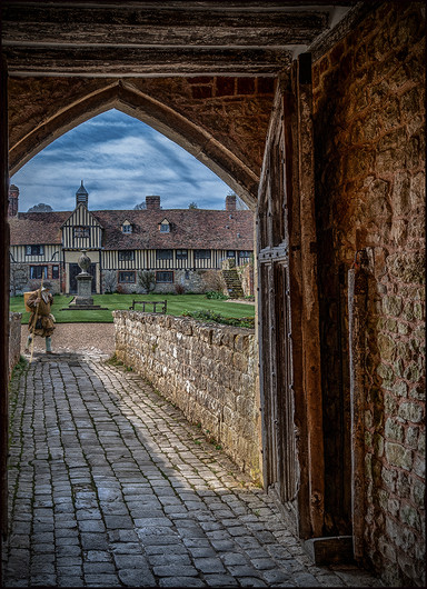 18 A VISITOR AT THE WEST GATE IGHTHAM MOTE by Mick Dudley