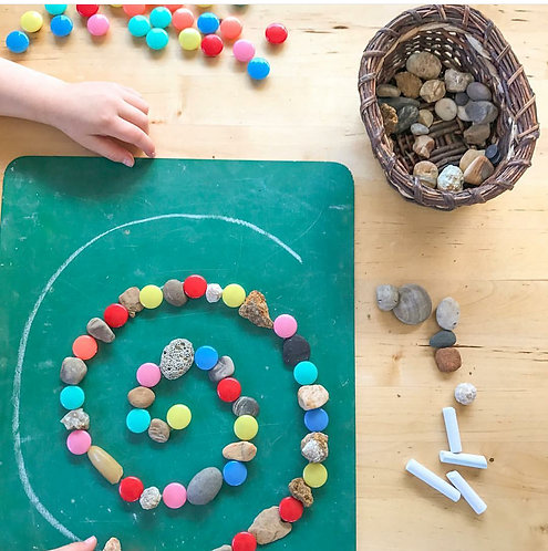 Writing board and colored rocks with chalk