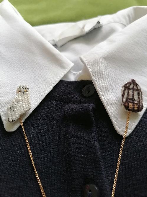 double pin's chouette harfang