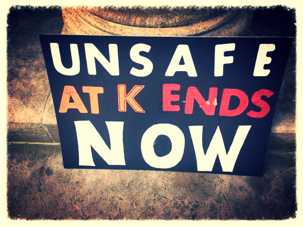 Sign by a student: UNSAFE AT K ENDS NOW