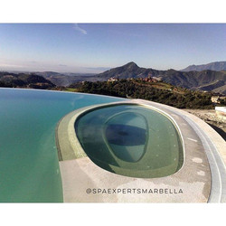 Custom Infinity swimming pool and spa construction, with a unique tiling pattern for one of our cust