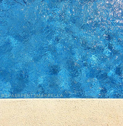 Contrast of the natural stone and the diamond blue water on site of one of our recent swimming pool