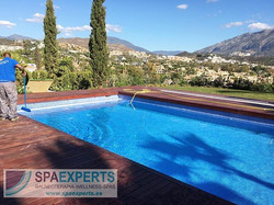 In this image our technician is filling up the pool and cleaning the surrounding area hours before h
