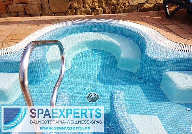 Details_ image of one of our custom outdoor overflow spa constructions, check out the perimeter benc