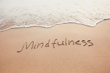 Mindfulness written in sand
