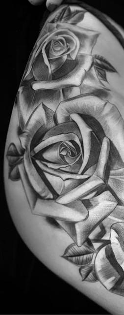 girl leg roses tattoo