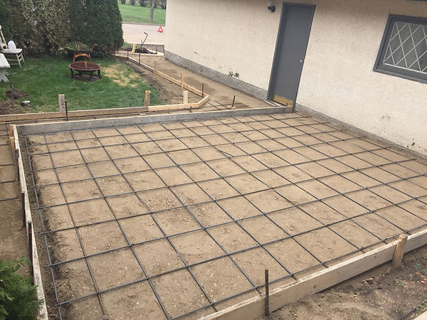 Concrete contractor for driveways, patios, stamped concrete and garage pads with free estimates