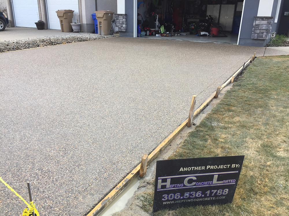 Here we have a concrete driveway replacement in exposed aggregate. This local concrete contractor was hired to remove and replace the old concrete driveway and replace it with a new concrete driveway in exposed aggregate. Hepting Concrete was the concrete contractor on this driveway project in Regina.