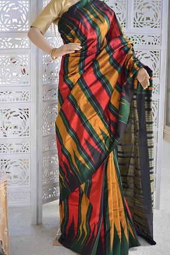 Black, maroon , gold and green with kumbha Bomkai silk