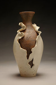 Thrown and altered ceramic vase
