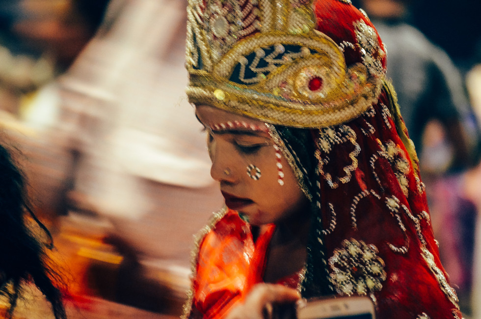 Child in costume at aarti on the Ganges in Varanasi, India