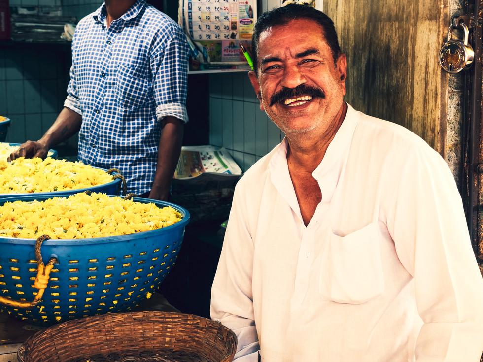 Smiles and flowers at Dadar Flower Market, Mumbai, India