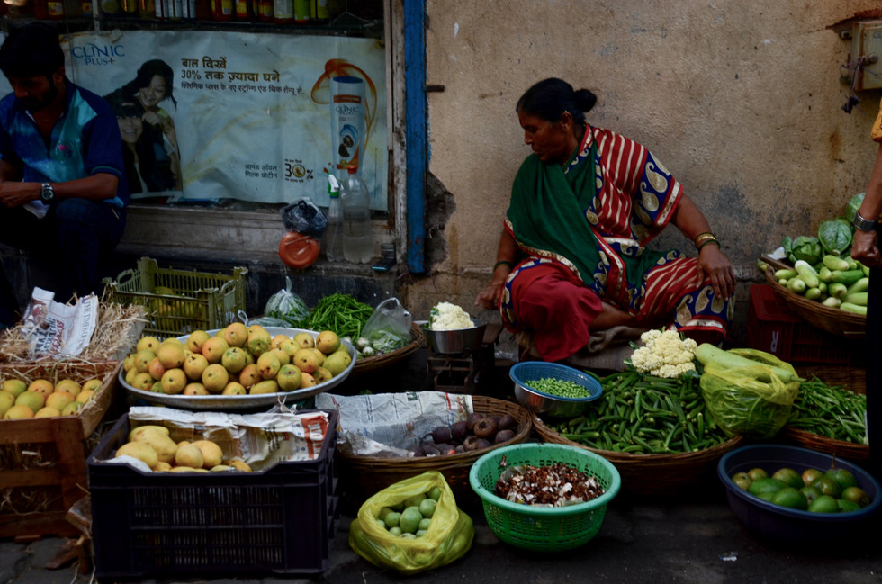 Fruit seller at market in Bandra West, Mumbai, India