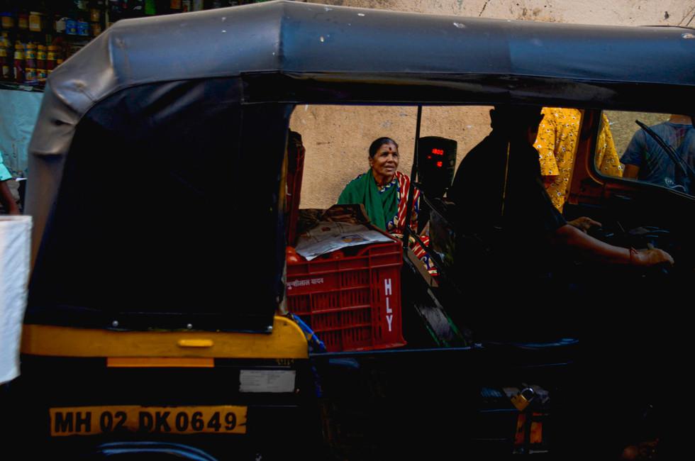 Market woman through the frame of a tuk-tuk, Bandra West, Mumbai, India