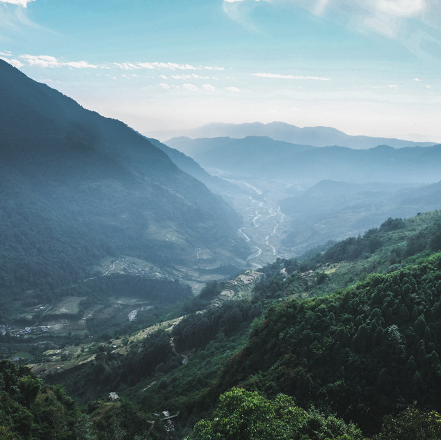 Green valleys and mountain sillhouettes in central Nepal