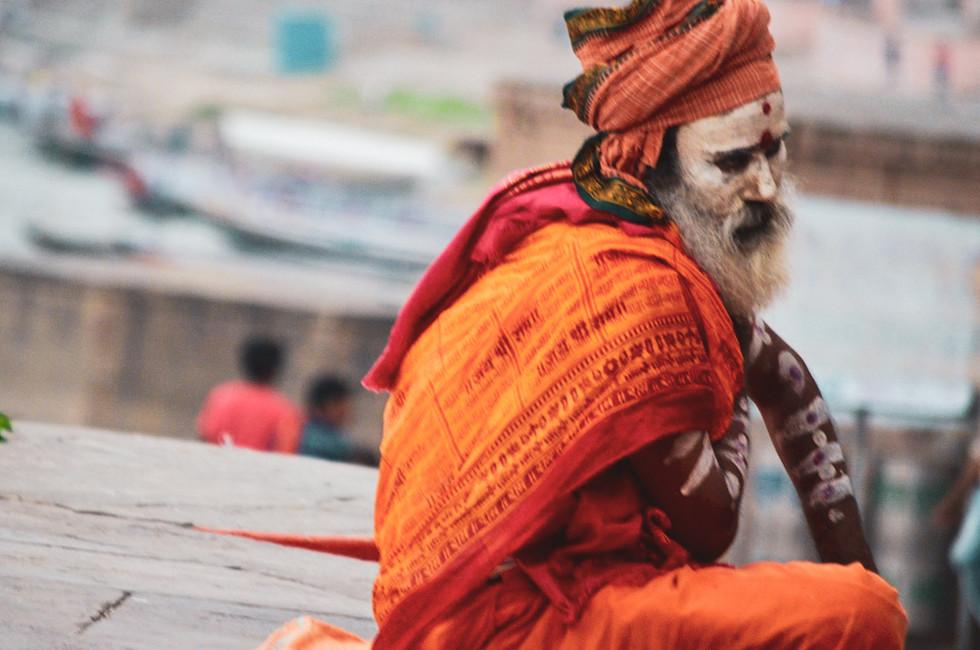 Saddhu meditating on steps along the Ganges in Varanasi, India