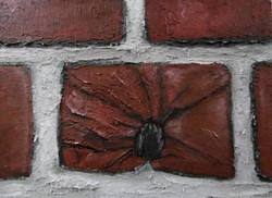 Bullet in brick