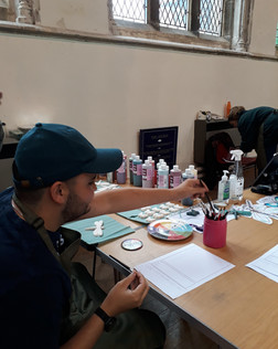 The White Nettle, painting a ceramic dragon fly at Green Sundays