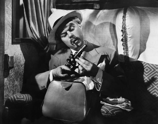 Marius Goring as Commandant Razinski in Highly Dangerous 1950