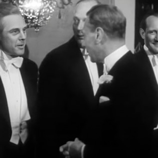 Marius Goring meeting King George VI at the Royal Command Film Performance of 'Odette' 7 June 1950. Maurice Buckmaster & Trevor Howard in the background.