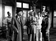 Marius Goring as Commandant Razinski with Wilfrid Hyde-White, Olaf Pooley & Anton Diffring in Highly Dangerous 1950
