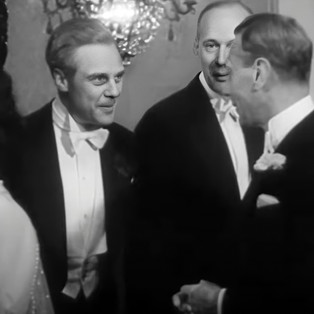 Marius Goring meeting King George VI at the Royal Command Film Performance of 'Odette' 7 June 1950. Maurice Buckmaster is standing next to Marius.