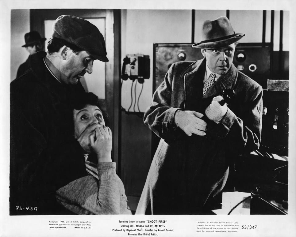 Joan Hickson as the Station Announcer & Marius Goring as Hiart in Rough Shoot 1953