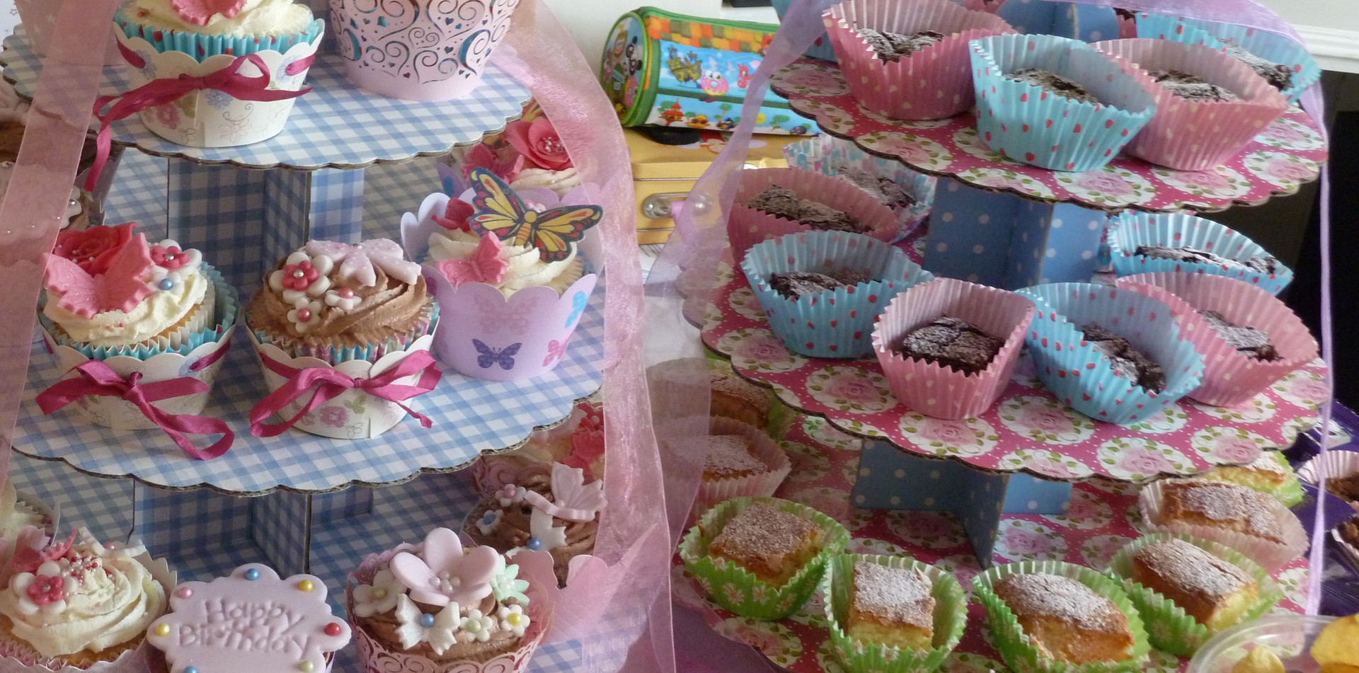 A selection of cupcakes and tray bakes
