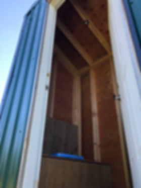 LED lighting intalled in the outhouse at Larsen Ridge by Step3Project.