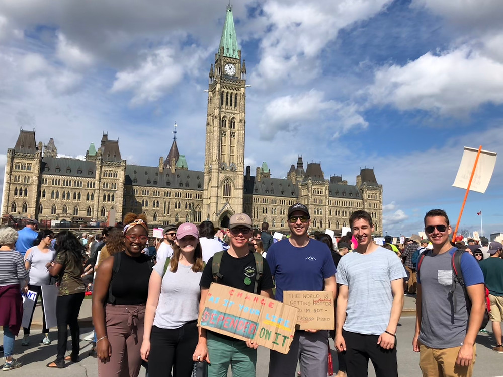 Students supporting the global climate strike at parliament hill in step3project clothing