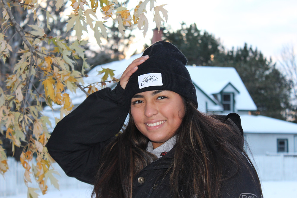 Girl in Step3 toque smiling at the camera