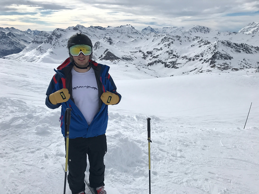 Man skiing in the mountains wearing a 7 sisters step3 crew neck and neff mitts