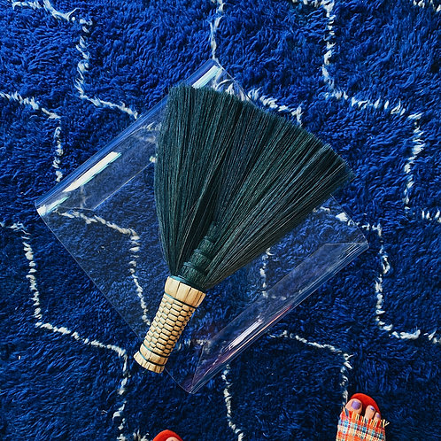 The Turquoise Sweeping Brush