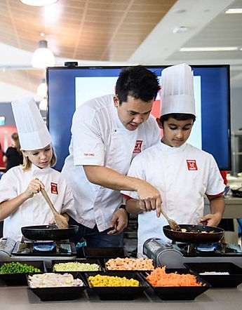 Chef Tim Ong of The Cooking Club, teaching a children's cooking class in Singapore