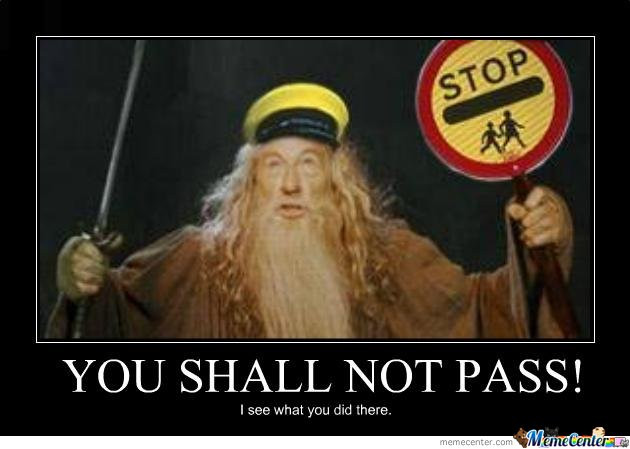 Gandalf holding sword and a stop sign.
