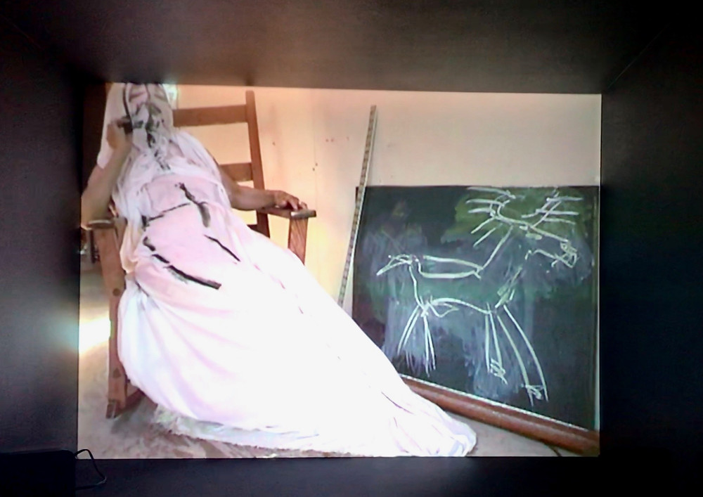 "Joan Jonas Drawing on herself in her video work ""My New Theatre III: In the Shadow a Shadow"""